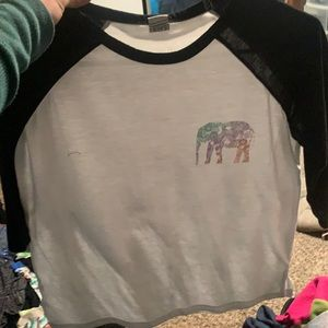 Black sleeves w/ white torso and colorful elephant